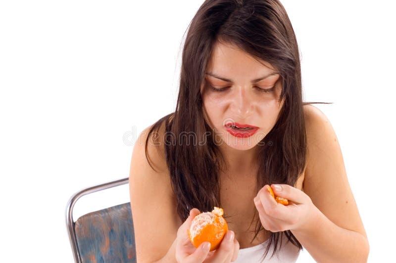 Het eten van sinaasappel royalty-vrije stock foto's