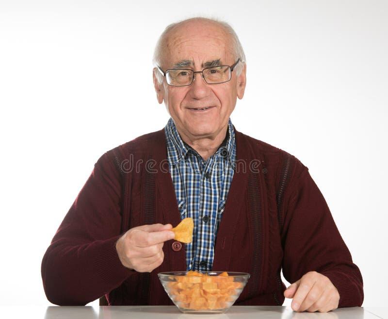 Het eten van spaanders royalty-vrije stock foto