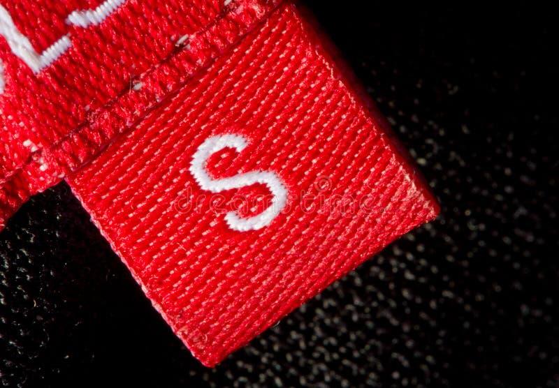 Het etiket van de grootte stock foto's