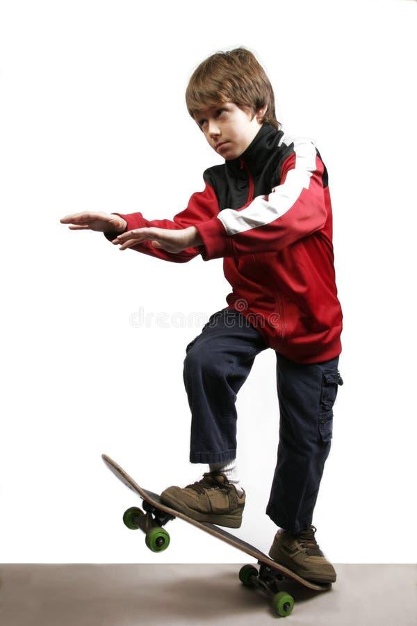 Het In evenwicht brengen van de jongen op Skateboard royalty-vrije stock foto's