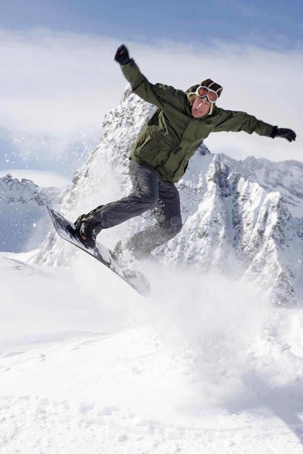 Het extreme snowboarding stock foto