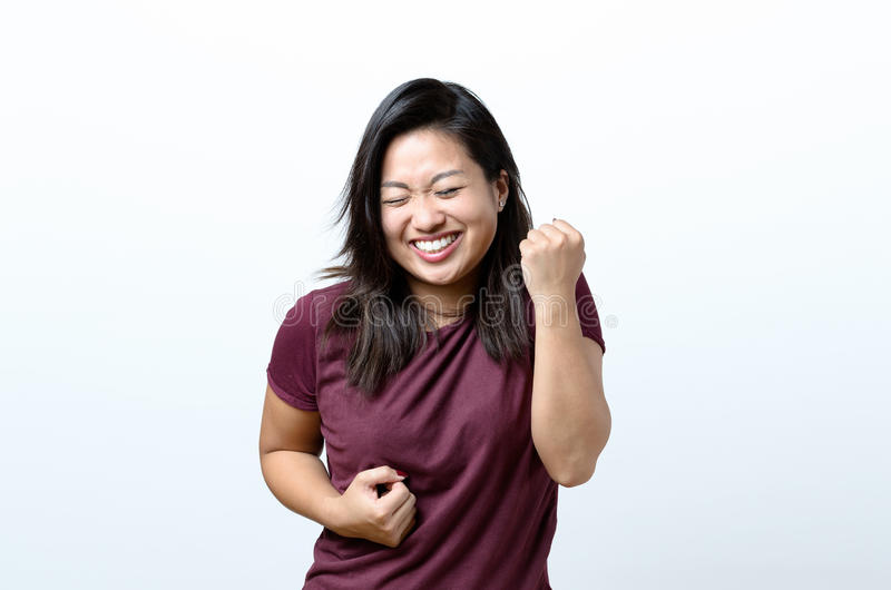 Het Exuberant jonge Chinese vrouw toejuichen stock foto