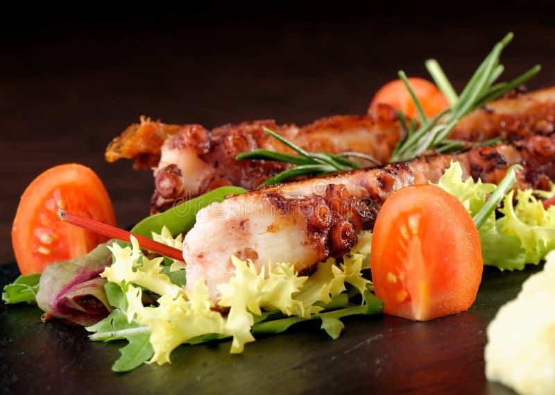 Het fijne dineren, Geroosterde octopus stock afbeeldingen