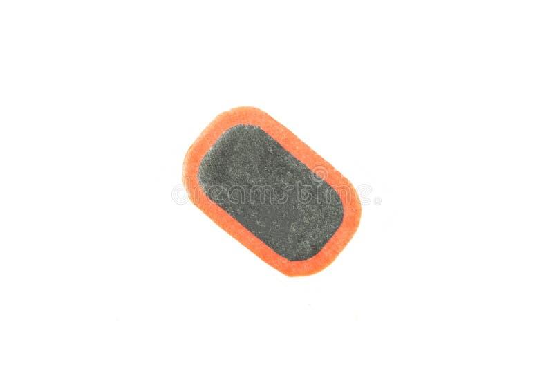 Het flard om rubberwielkamers, close-up te vernietigen, isoleert, lapt op stock foto