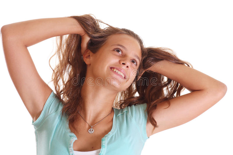 Het fluffing haar van de tiener royalty-vrije stock foto