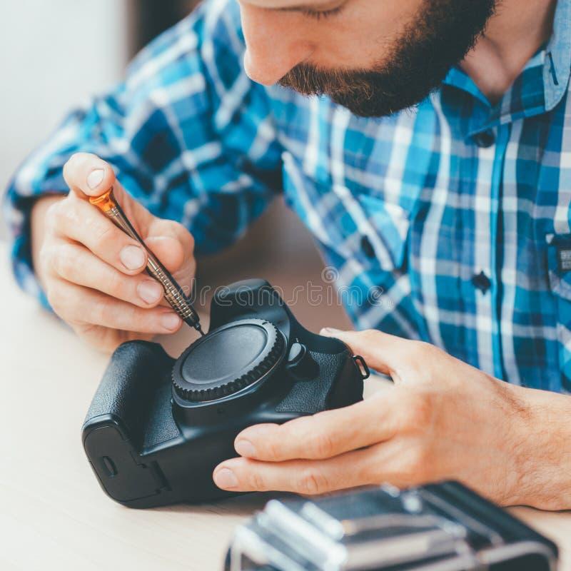 Het fotograferen van de camera van het materiaalonderhoud stock foto's