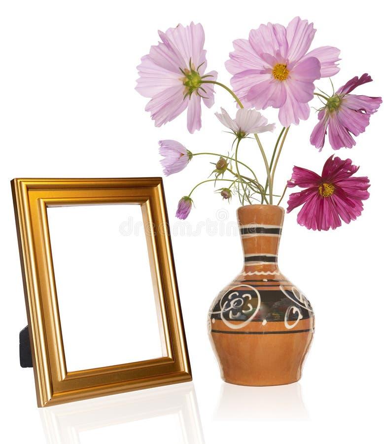 Het frame van de foto en antieke vaas stock foto