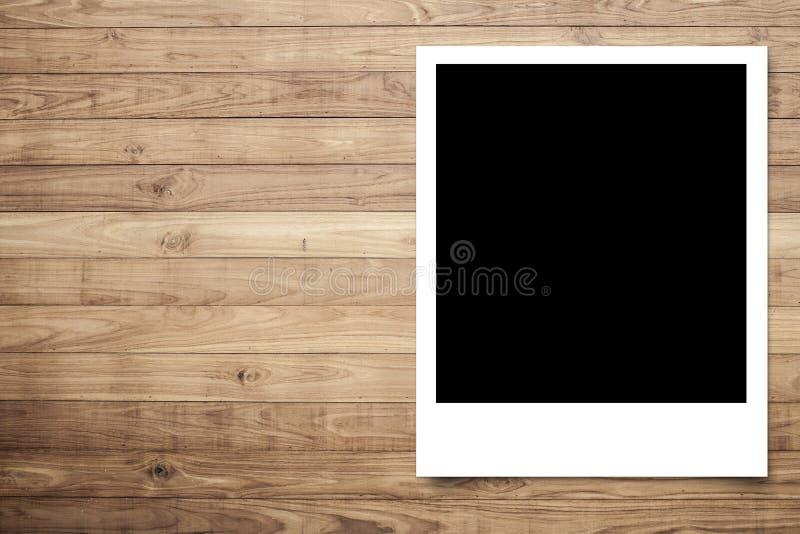 Het frame van de foto op Bruine houten plank royalty-vrije stock foto's