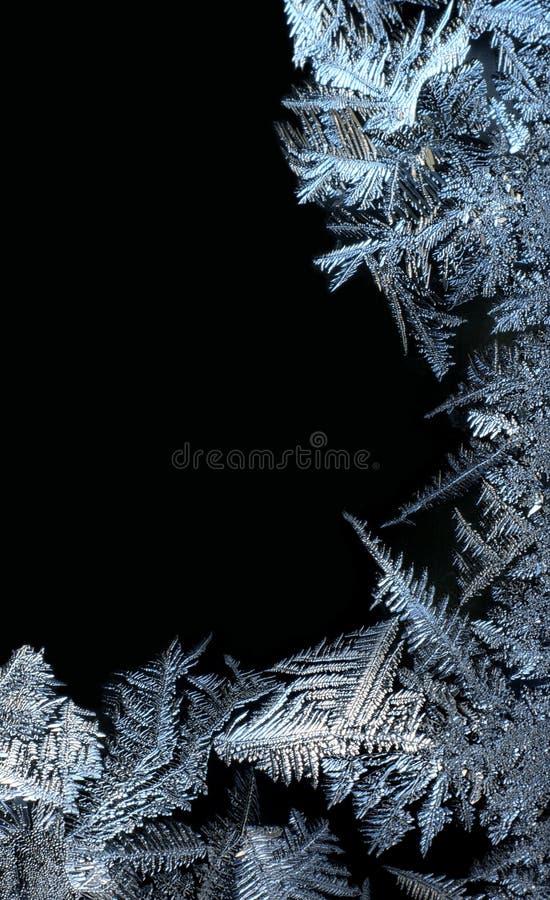 Het frame van de vorst op zwarte royalty-vrije stock foto