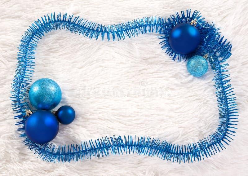 Het frame van Kerstmis met klatergoud royalty-vrije stock foto's