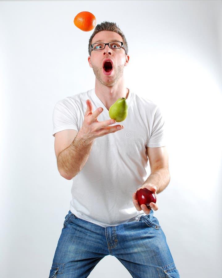 Het fruit jongleert met stock foto