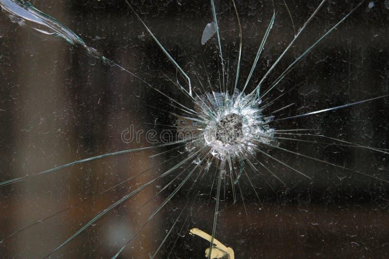 Het Gat van de kogel in Glas stock afbeelding