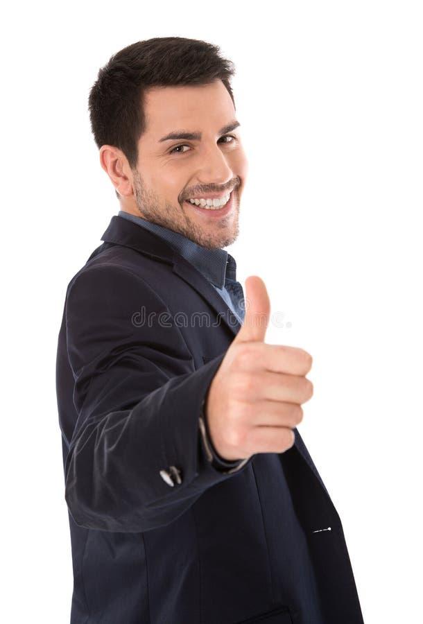 Het geïsoleerde het glimlachen zakenman maken beduimelt omhoog gebaar royalty-vrije stock foto's