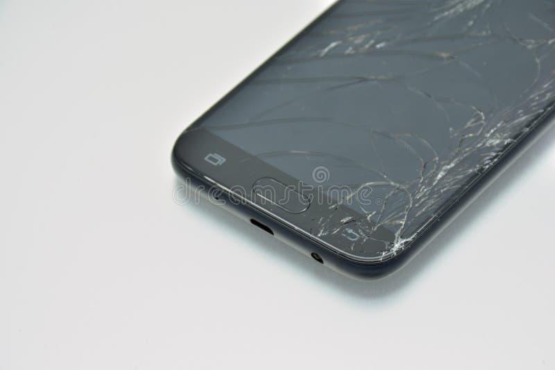 Het gebroken mobiele telefoonscherm stock foto