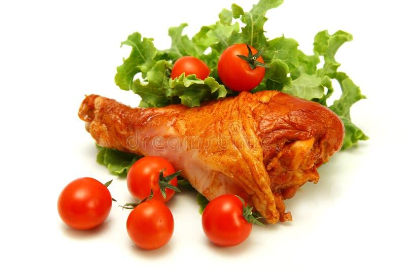 Het gediende been van Turkije met tomaten stock fotografie