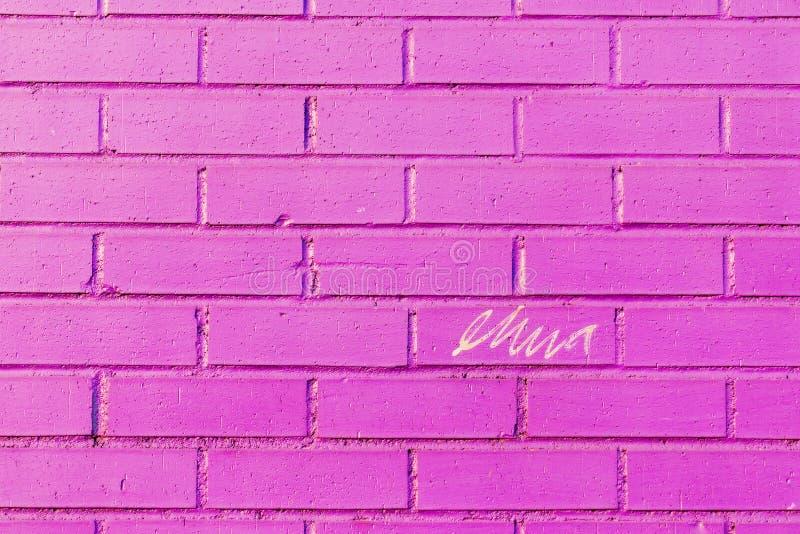 Het gekrabbel op a bricked muur royalty-vrije stock foto