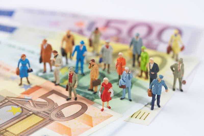 Het geld beslist de wereld stock fotografie