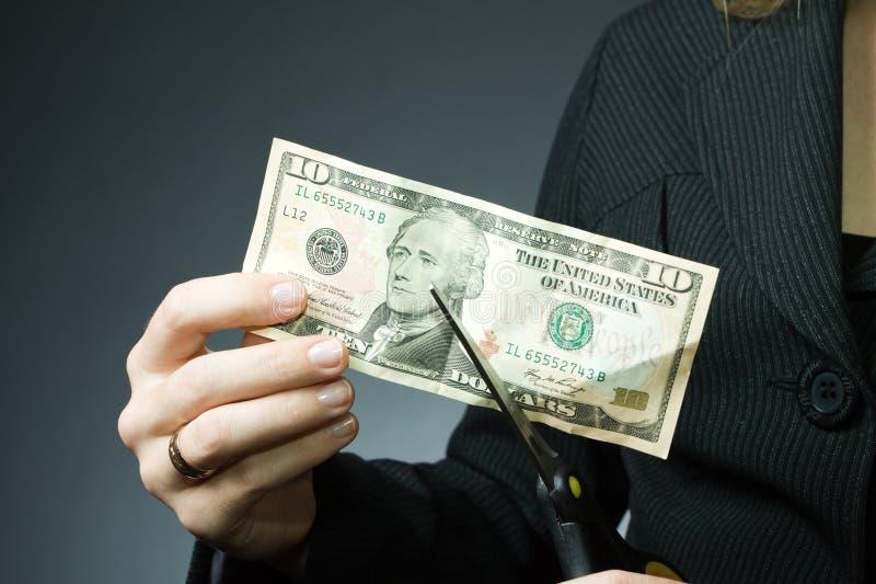 Het geld van de besnoeiing stock afbeeldingen