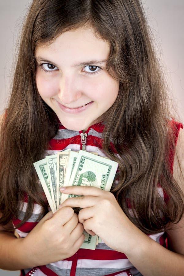 Het geld van de tienerholding royalty-vrije stock foto's