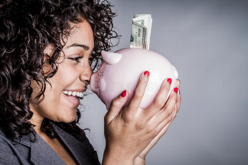 Het geld van de vrouwenbesparing royalty-vrije stock foto