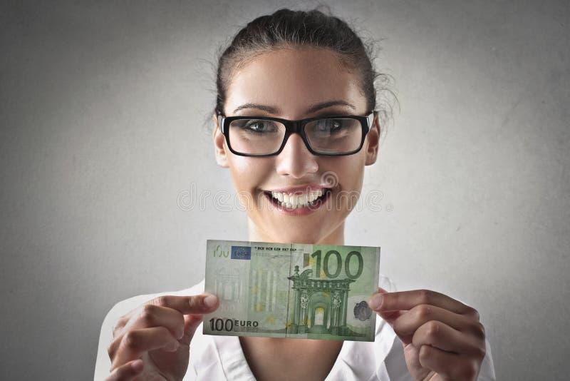 Het geld van de vrouwenholding royalty-vrije stock foto's