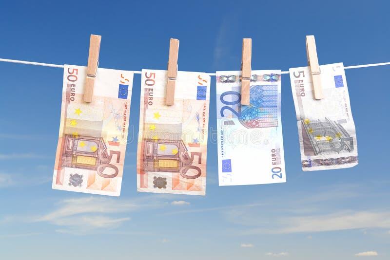 Het geld van de wasserij stock afbeelding