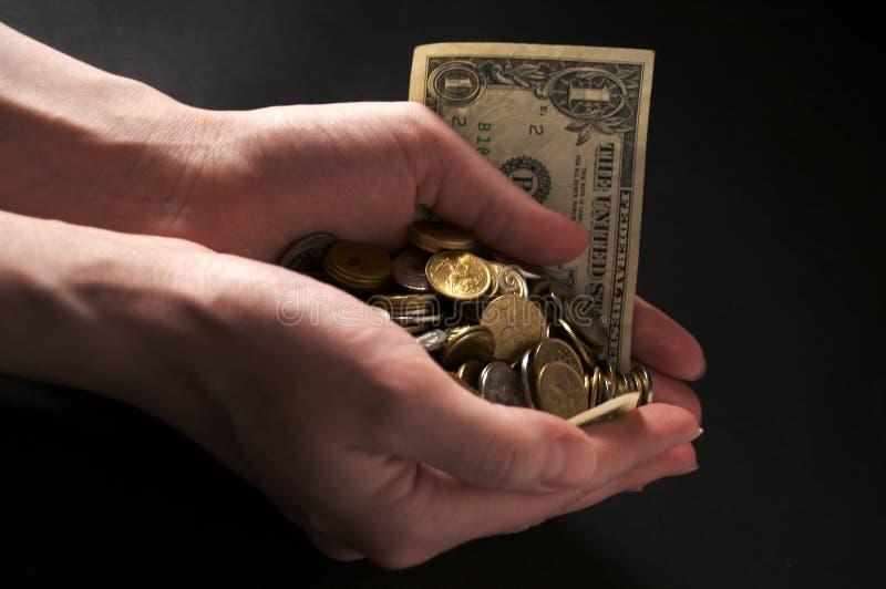 Het geld van het handvol stock afbeeldingen