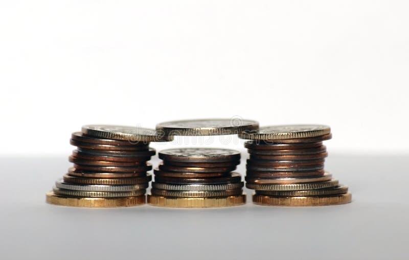 Het geldpiramide van muntstukken stock fotografie