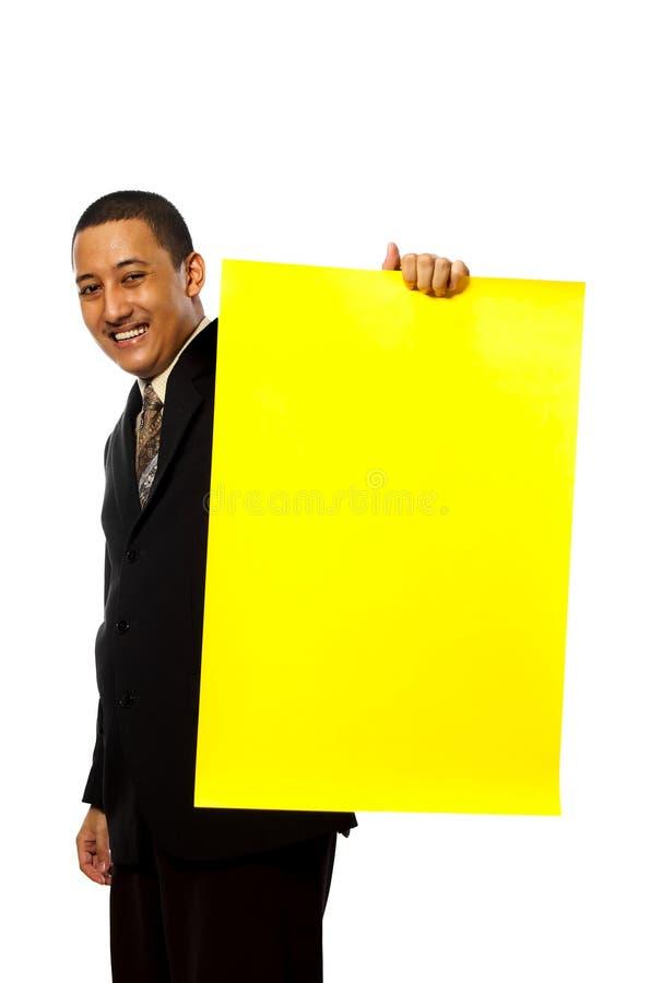 Het Gele Teken Greep van de bedrijfs van de Mens royalty-vrije stock fotografie