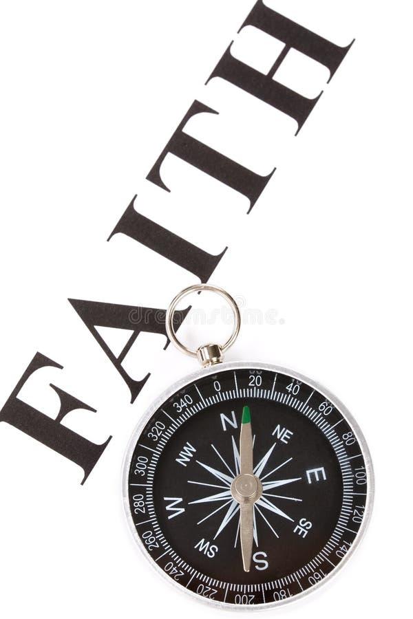 Het geloof en het Kompas van de krantekop royalty-vrije stock fotografie