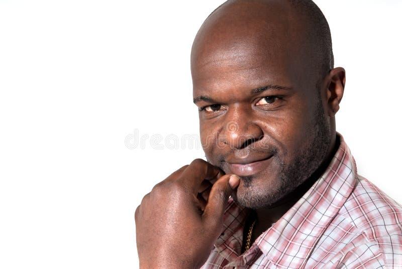 Het gelukkige Afrikaanse zakenman glimlachen stock foto's