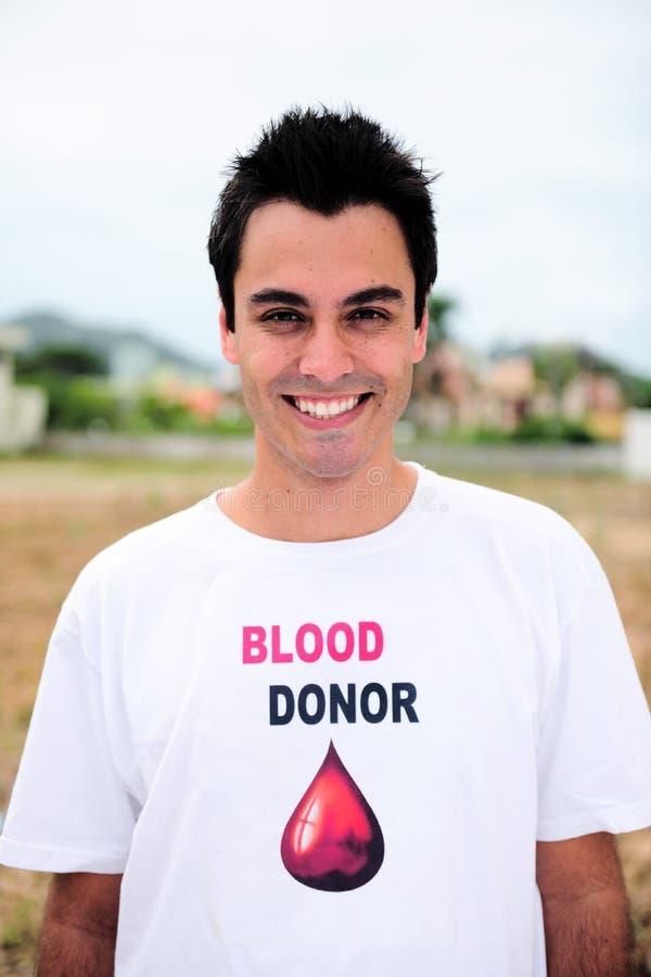 Het gelukkige bloed donar glimlachen stock afbeeldingen
