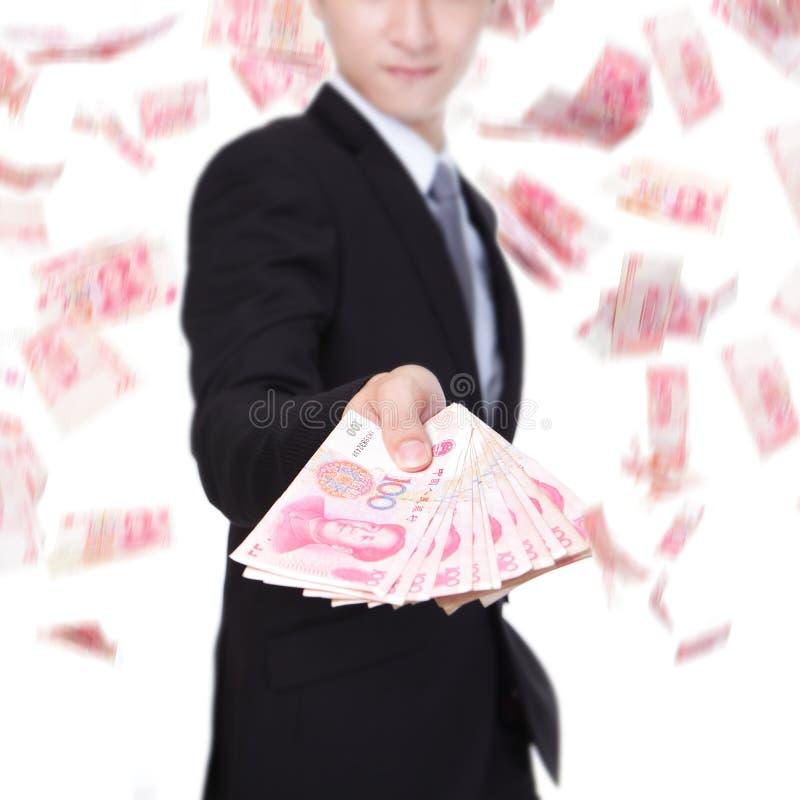 Het gelukkige geld van China van de bedrijfsmensengreep stock fotografie