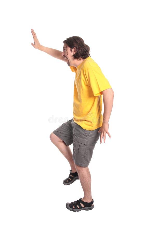 Het gelukkige jonge mens dansen stock fotografie