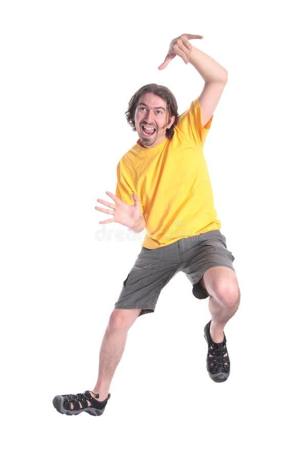 Het gelukkige jonge mens dansen stock foto's