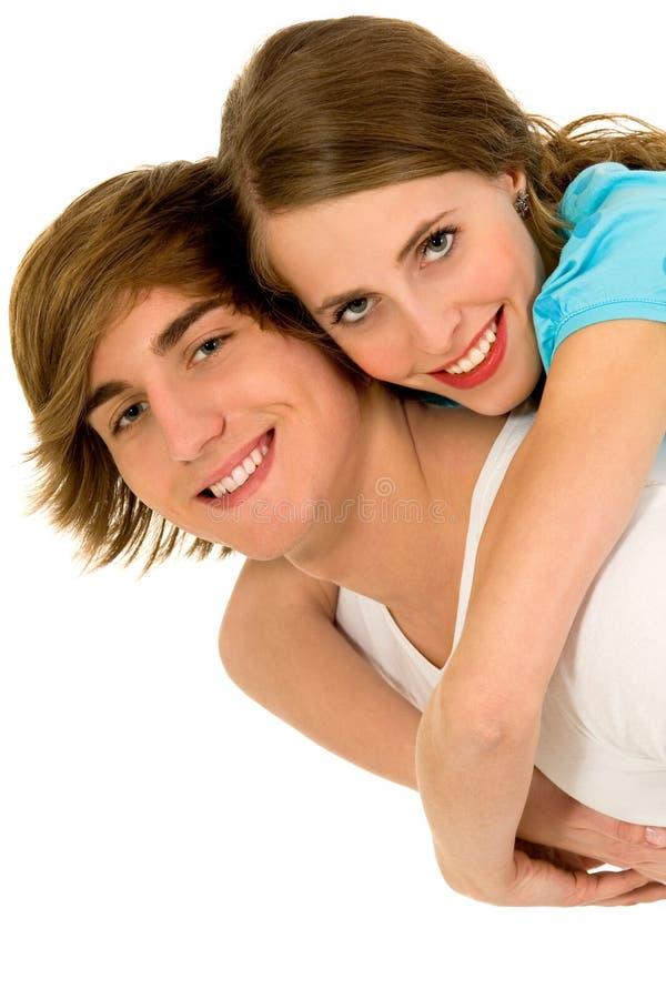 Het gelukkige jonge paar koesteren royalty-vrije stock afbeelding