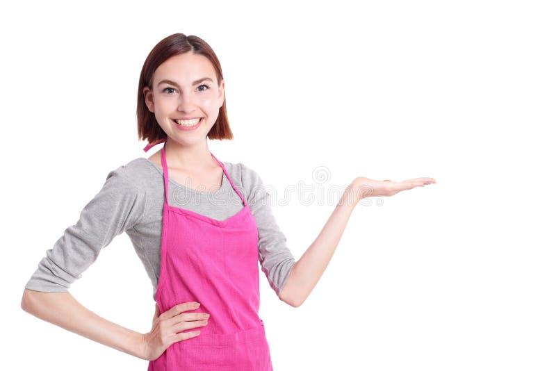 Het gelukkige jonge vrouwenhuisvrouw tonen stock foto