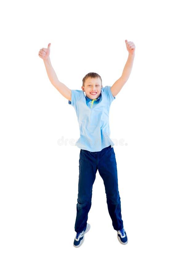 Het gelukkige jongen springen royalty-vrije stock afbeeldingen