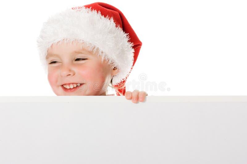 Het gelukkige kind van Kerstmis met de raad stock fotografie