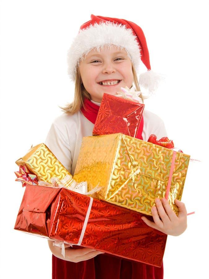 Het gelukkige kind van Kerstmis met giften in de dozen stock fotografie