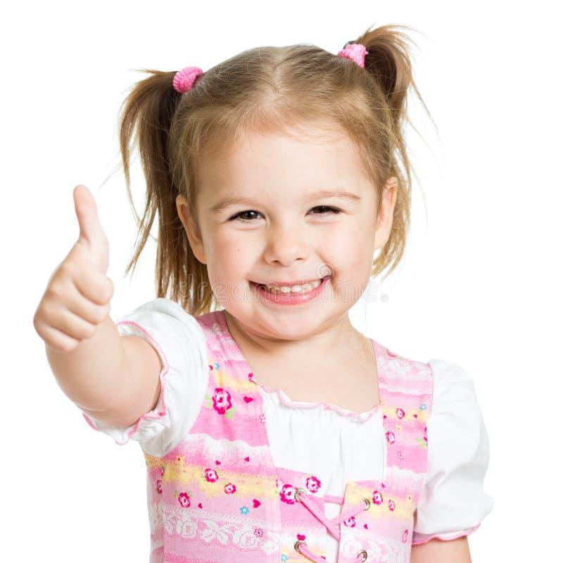 Het gelukkige kindmeisje met handen beduimelt omhoog stock fotografie