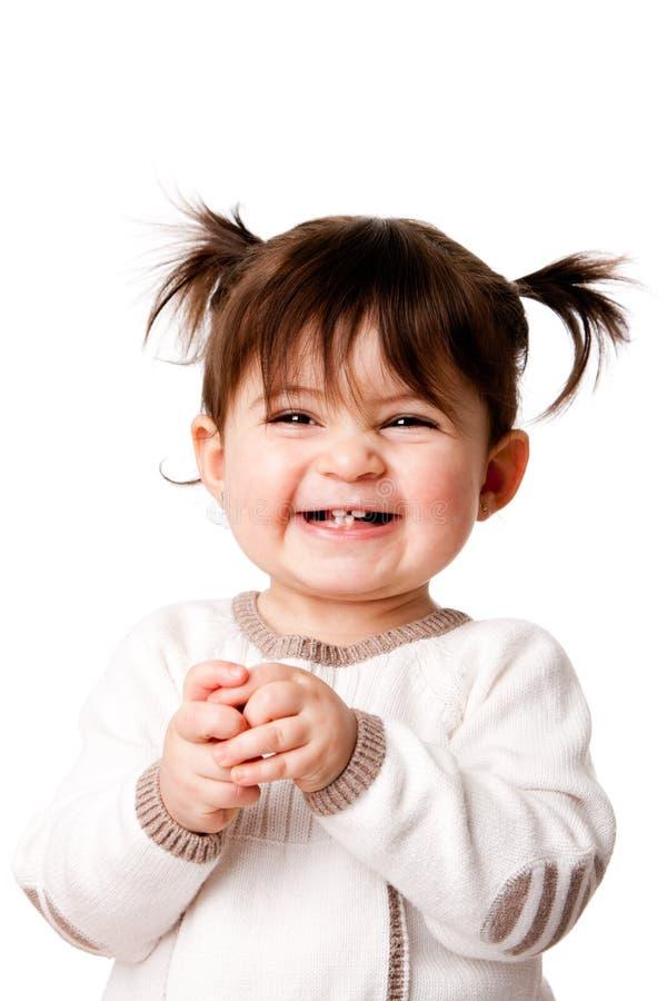 Het gelukkige lachende meisje van de babypeuter royalty-vrije stock foto