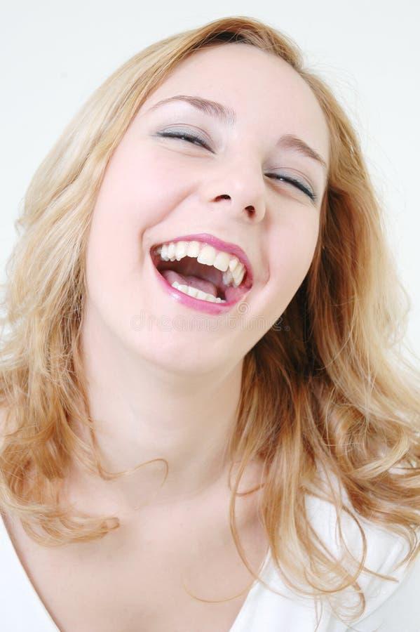 Het gelukkige meisje lachen royalty-vrije stock afbeeldingen