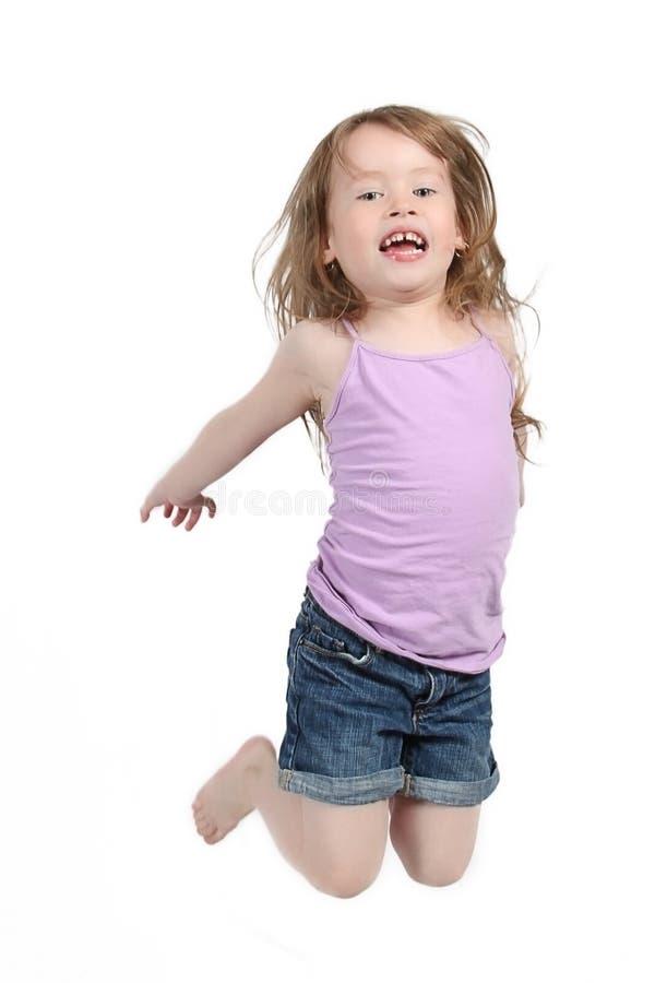 Het gelukkige meisje springen royalty-vrije stock foto's