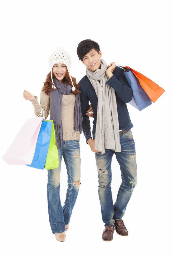 Het gelukkige paar doen die met de winterkleding winkelen royalty-vrije stock foto