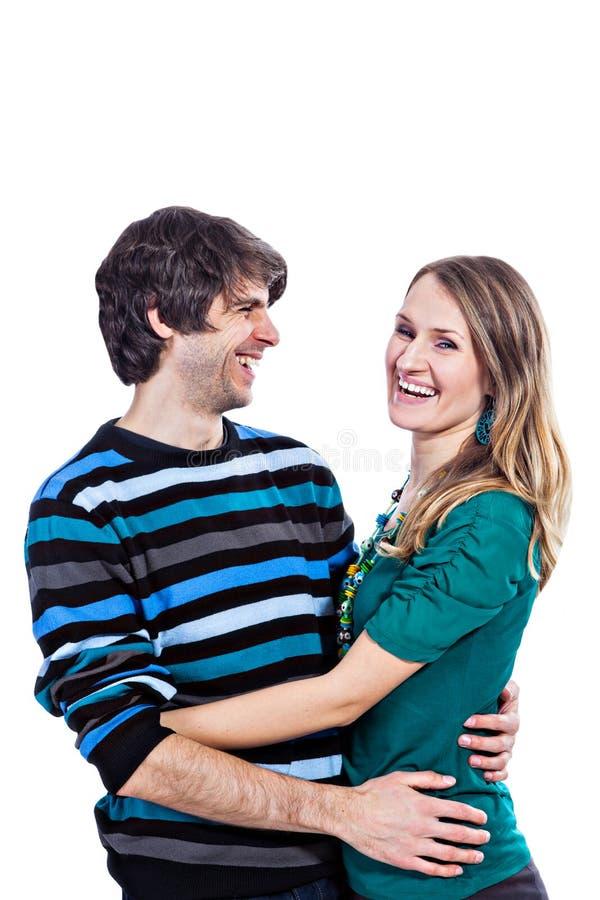Download Het Gelukkige Paar Koesteren Stock Afbeelding - Afbeelding bestaande uit achtergrond, vrouw: 29501117