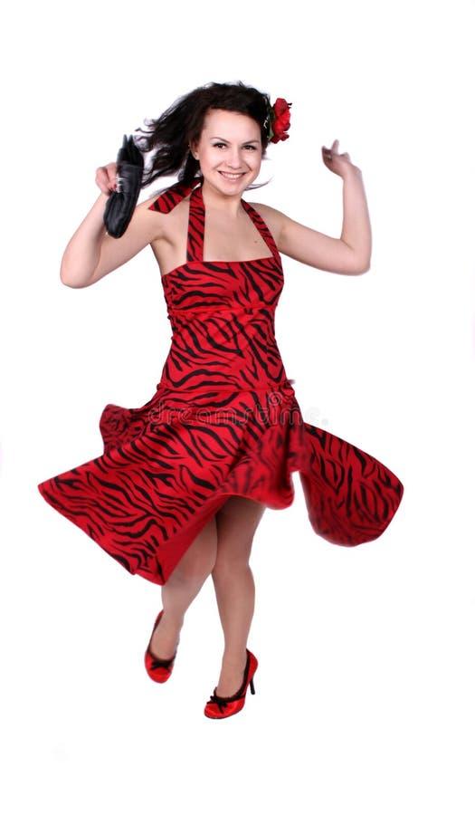 Het gelukkige pinupmeisje dansen stock foto
