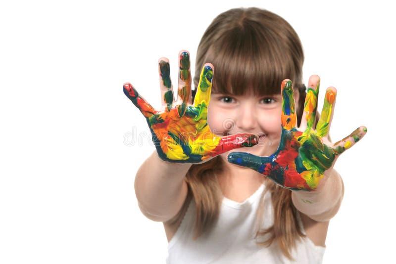 Het gelukkige PreJonge geitje van de School met Geschilderde Handen stock foto's
