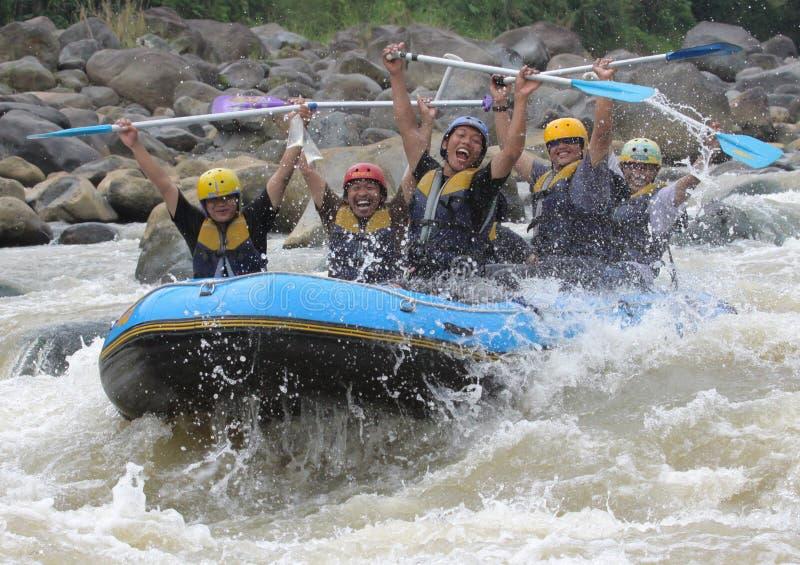 Het gelukkige rafting  stock foto