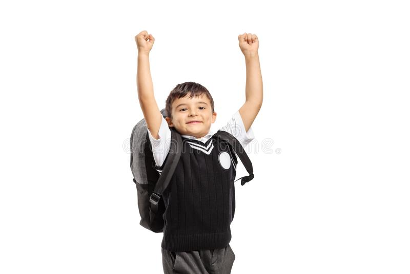 Het gelukkige schooljongen springen stock fotografie